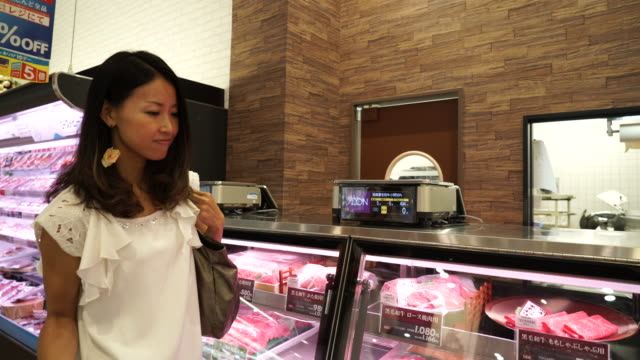 young woman butcher is measure the meat - only japanese stock videos & royalty-free footage