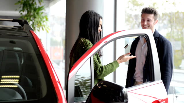 Young woman buying a new car