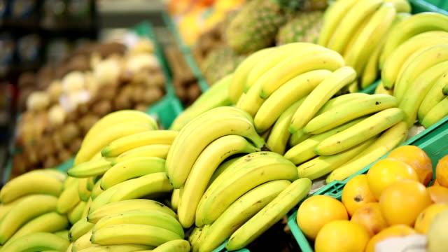 young woman buying bananas - banana stock videos & royalty-free footage
