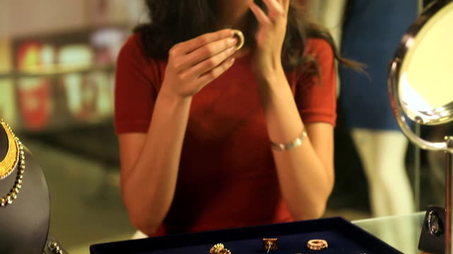 young woman buying jewellery at shopping mall, delhi, india - indian ethnicity stock videos & royalty-free footage