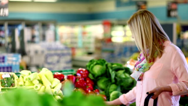 young woman buying vegetable - red bell pepper stock videos & royalty-free footage