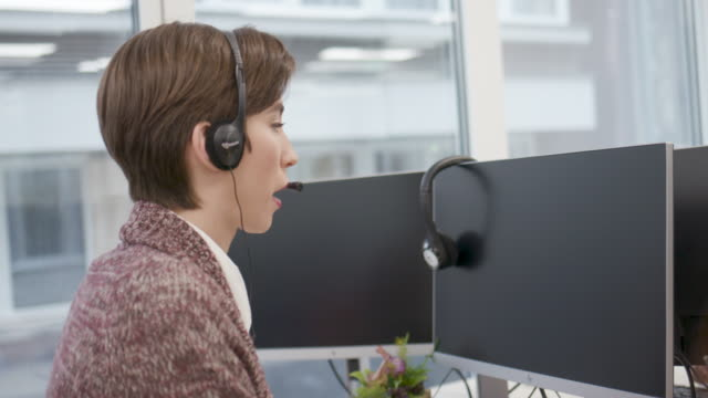 young woman call center worker - headset stock videos & royalty-free footage