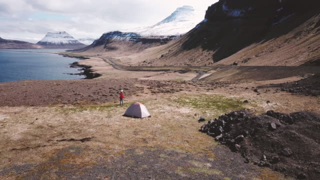 young woman camping near the ocean in iceland, aerial view - roadside stock videos and b-roll footage