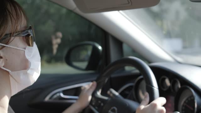 young woman car driver - camicetta video stock e b–roll