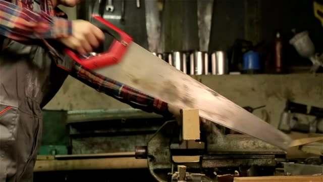 young woman carpenter cutting a board whit saw,close up - blade stock videos & royalty-free footage