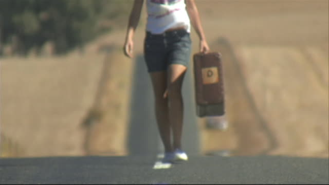 young woman carrying suitcase, cape town, south africa - runaway stock videos & royalty-free footage