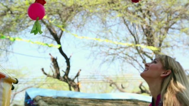 young woman catching wall hangings, suraj kund, faridabad, haryana, india - haryana stock videos & royalty-free footage