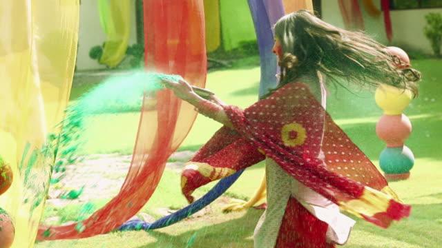 Young woman celebrating holi festival, Delhi, India
