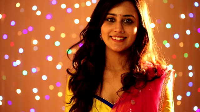 young woman celebrating raksha bandhan, delhi, india - nose piercing stock videos & royalty-free footage