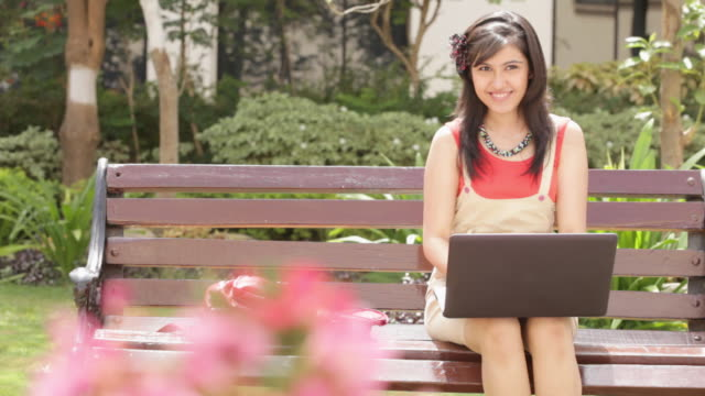 Young woman chatting on a laptop