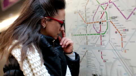 young woman checking the tourist city map - public transport stock videos & royalty-free footage