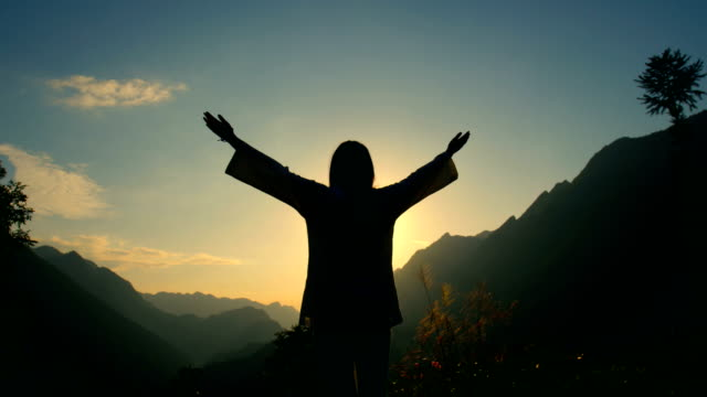 young woman cheerful on top of the mountain - arms raised stock videos & royalty-free footage