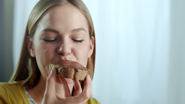 young woman chocolate spread - sandwich stock videos & royalty-free footage