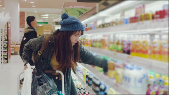 young woman chooses dairy produce in the store - dairy product stock videos & royalty-free footage