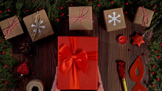 4K Young woman, Christmas Red Gift Box.