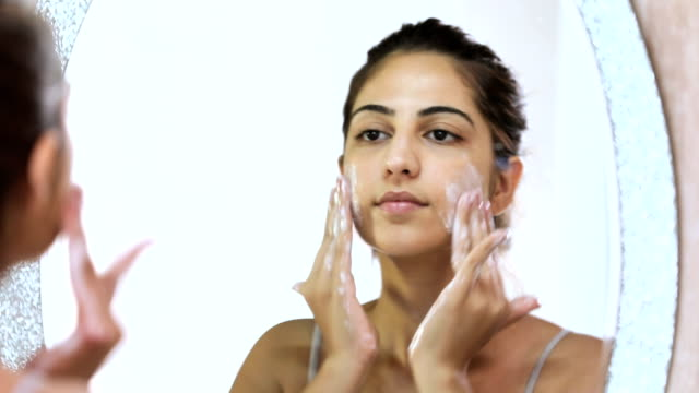 young woman cleaning face in bathroom, delhi, india - washing face stock videos & royalty-free footage