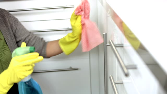 HD: Young Woman Cleaning The Kitchen