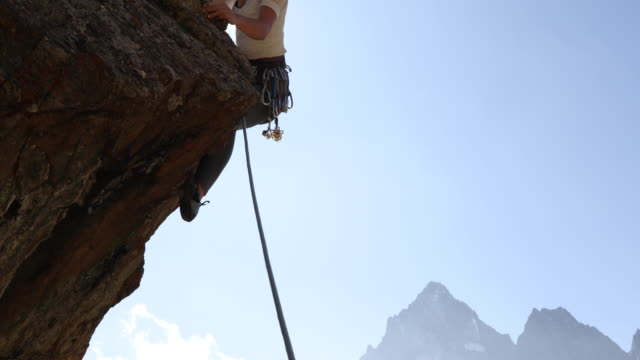 young woman climbs overhanging rock buttress - climbing rope stock videos & royalty-free footage