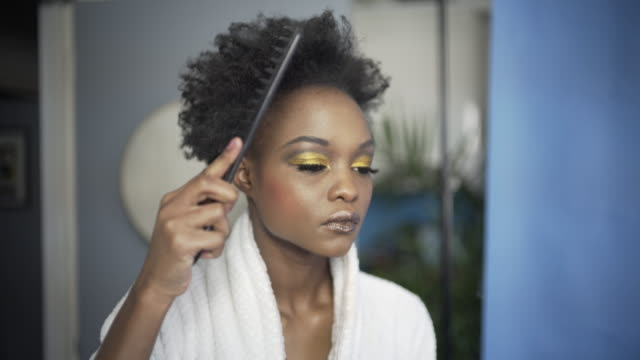 a young woman combing her afro hair. - afro stock videos & royalty-free footage