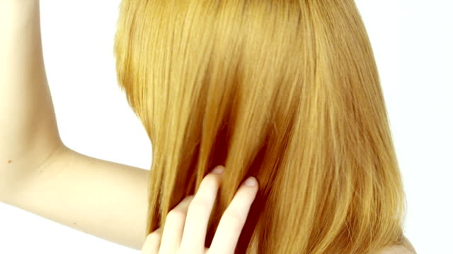 young woman combing her hair. - long hair stock videos and b-roll footage