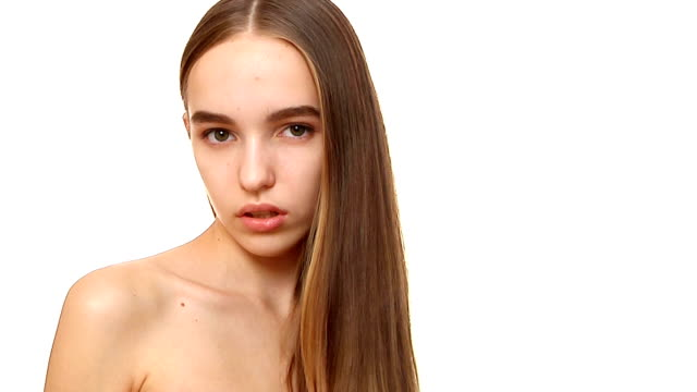 young woman combing her hair - straight hair stock videos & royalty-free footage