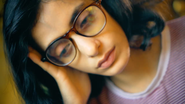 young woman contemplates deeply at home. - headache stock videos & royalty-free footage