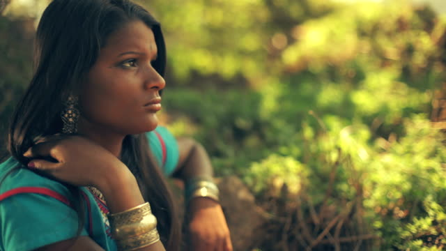 young woman contemplates in outdoor nature. - indigenous culture stock videos & royalty-free footage