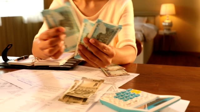 """""""cu young woman counting indian fifty rupee notes at home / new delhi, delhi, india """" - home finances stock videos & royalty-free footage"""