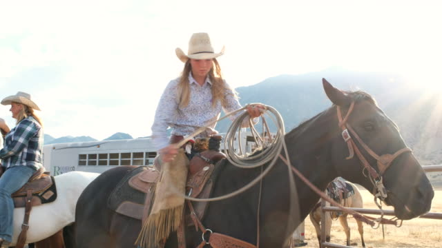 young woman cowgirl on a horse - women doing farm animals stock videos and b-roll footage