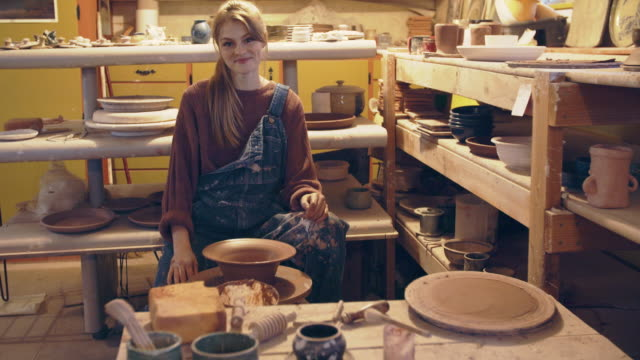young woman creating in her ceramics studio - ponytail stock videos & royalty-free footage