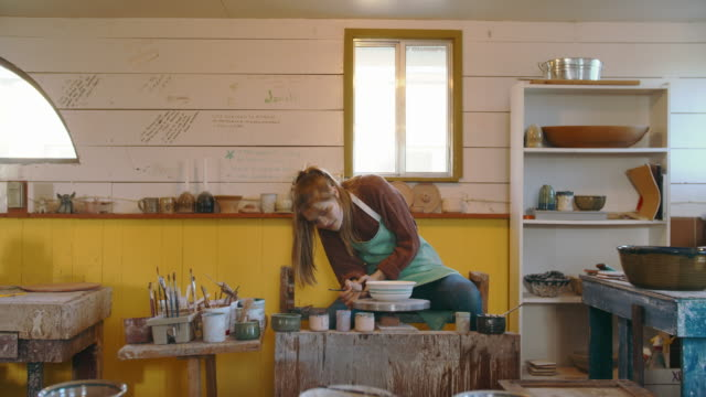 young woman creating in her ceramics studio - pottery stock videos & royalty-free footage