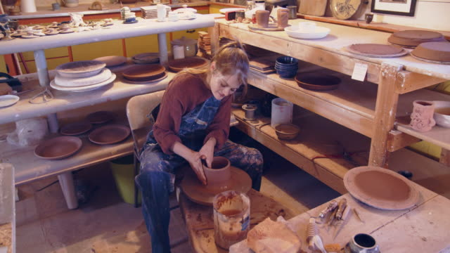 young woman creating in her ceramics studio - creation stock videos & royalty-free footage