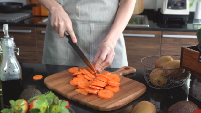 young woman cutting carrot - kitchenware department stock videos and b-roll footage