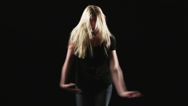 stockvideo's en b-roll-footage met ms young woman dancing against black background / orem, utah, usa - orem utah