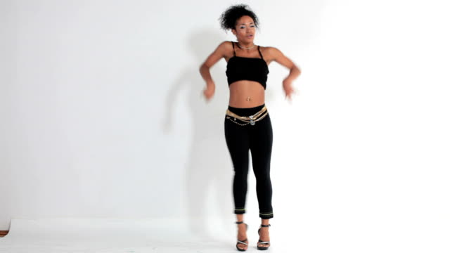 WS Young woman dancing against white background / New York, New York, USA