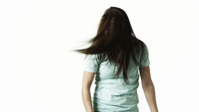 ms young woman dancing against white background / orem, utah, usa - orem utah stock videos & royalty-free footage