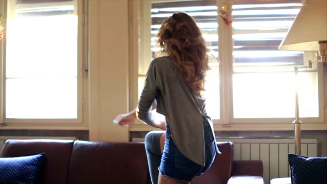 hd dolly: young woman dancing in  home - sandal stock videos and b-roll footage