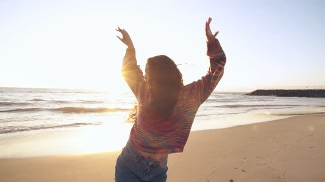 young woman dancing on the beach at sunset - cool attitude stock videos & royalty-free footage
