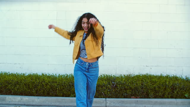 young woman dancing on the street - yellow stock videos & royalty-free footage
