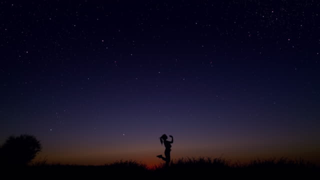 young woman dancing under the starry sky - modern dancing stock videos & royalty-free footage