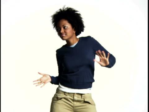 young woman dancing - fotografia da studio video stock e b–roll