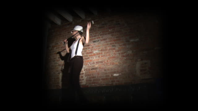 ws young woman dancing with white hat and cane in front of brick wall, new york city, new york, usa - suspenders stock-videos und b-roll-filmmaterial