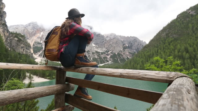 stockvideo's en b-roll-footage met a young woman day hiking in the dolomite mountains of italy. - one mid adult woman only