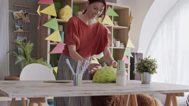young woman decorating table for her dog's birthday party - decoration stock videos & royalty-free footage