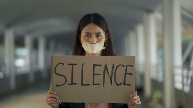 young woman demonstrating with adhesive tape on her mouth for silence sign - social justice concept stock videos & royalty-free footage