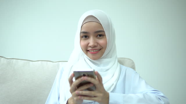 young woman dials message on mobile phone - south east asian ethnicity stock videos & royalty-free footage