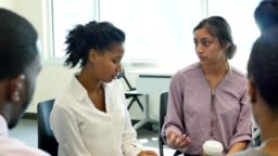 Young woman discusses something during group therapy session