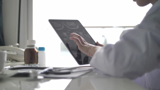 young woman doctor using tablet. slow motion - form filling stock videos & royalty-free footage