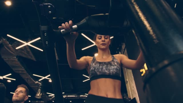 young woman doing cardio on stair climbing machine at the gym - cross trainer stock videos & royalty-free footage
