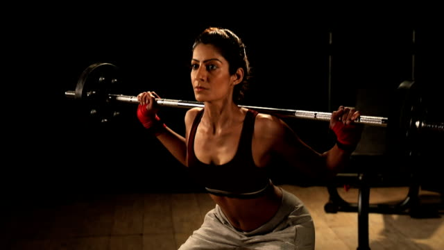 young woman doing exercising at health club, delhi, india - genderblend stock videos & royalty-free footage